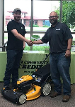 1st-time Homebuyer Kolten pictured with his new lawnmower and Michael Garcia