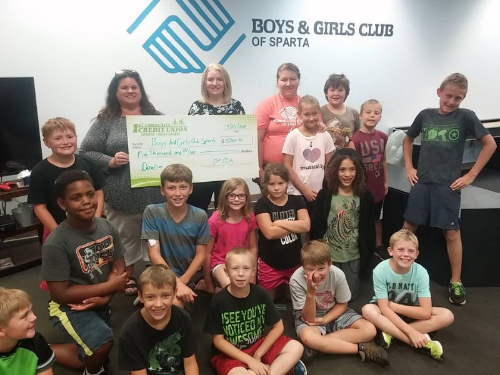 "group photo of $5,000 donation made by 1st CCU to the Sparta Boys & Girls Club's ""House of Shadows"""