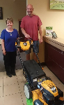1st-time homebuyer Richard, picture with his new lawnmower and Barb Burnham, Mortgage Loan Officer.