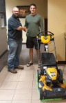 1st time homebuyer Ethan with his new free lawnmower and Michael 'The Mortgage Guy' Garcia