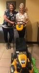 1st-Time Home Buyer Amber pictured with her free lawnmower, and Molli Hundt, Mortgage Loan Officer. NMLS 488022