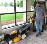 1st-time homebuyer Jon with his new free lawnmower
