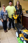1st-time homebuyers Olivia and Scott, pictured with their new lawnmower and Barb Burnham, Mortgage Loan Officer