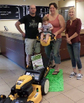 1st time home buyers pictured with free lawnmower