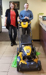 1st-time Homebuyer Devin pictured with his new lawnmower and Mortgage Loan Officer Molli Hundt