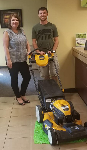1st time homebuyer Shane, pictured with his new lawnmower and Molli Hundt, Mortgage Loan Officer