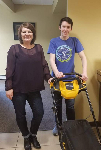First time homebuyer Jake pictured with his new lawnmower and Molli Hundt, Mortgage Lender NMLS488022