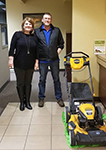 1st-Time Homebuyer Mike pictured with his free lawnmower and Molli Hundt, Mortgage Loan Officer.