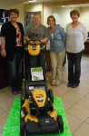 1st time home buyers with lawnmower, pictured with Molli Hundt