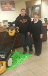 1st time home buyer with free lawnmower, pictured with Barb Burnham