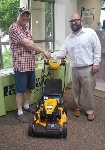 Matt, a 1st-Time home buyer, pictured with his new lawnmower and Michael Garcia, Mortgage Loan Officer