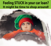 young woman looking out from snow covered car. Feeling stuck in your car loan? It might be time to shop around.