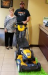 1st-Time Home Buyer Tom, pictured with his free lawnmower and Barb Burnham, Mortgage Loan Officer.