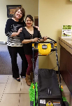 1st time homebuyer Elitzadely pictured with her new lawnmower, and Molli Hundt, Mortgage Loan Officer