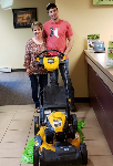 1st-time Homebuyer Paul pictured with Barb Burnham, Mortgage Loan Officer, and his free lawnmower