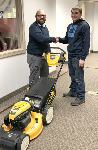 1st time home buyer with free lawnmower, pictured with Michael Garcia