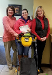 1st Time Homebuyer Sierra pictured with her new free lawnmower and Mortgage Lender Molli Hundt and Realtor Marta Volden