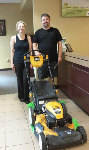 Nicholas and Melissa, first-time homebuyers, pictured with their free lawnmower