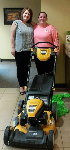 1st Time Homebuyer Emily, pictured with her new free lawnmower and Molli Hundt, Mortgage Loan Officer