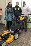 First time homebuyers pictured with their new lawnmower and Scott White, Mortgage Lender NMLS82835