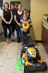 1st time homebuyers Eric and Jennifer pictured with their children and their new lawnmower. Also pictured is Molli Hundt, Mortgage Lender