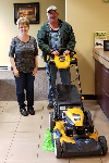 1st-time homebuyer Tim pictured with his new lawnmower and Barb Burnham-Mortgage Loan Officer