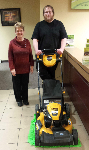 1st time home buyers with his new lawnmower, pictured with Barb Burnham, Mortgage Loan Officer.