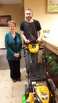 1st time home buyer with lawnmower, pictured with Barb Burnham