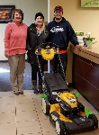 1st Time Homebuyers Sarah and Conner pictured with Mortgage Lender Molli Hundt and their new free lawnmower