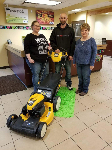 1st time home buyers with free lawnmower, pictured with Barb Burnham