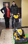 1st time homebuyer Stacy pictured with his new lawnmower and Molli Hundt, Mortgage Loan Officer