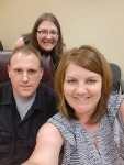 1st-Time Home Buyer Brad, pictured with Mary and Molli Hundt, Mortgage Loan Officer, at home loan closing