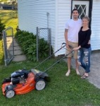 1st-time home buyer Jon and fiance Elyssa with their new free lawnmower