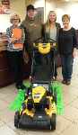 1st time home buyers with lawnmower, pictured with Barb Burnham