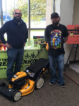 1st-time homebuyer Brandon pictured with Michael Garcia-Mortgage Loan Officer and his new lawnmower