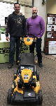 1st Time Home buyer B. Modlin picture with Scott White, Mortgage Lender and the lawnmower he got at closing.