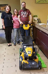 First-time homebuyers Marty and Jenna pictured with Molli Hundt and their new lawnmower