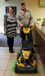 1st time Homebuyer pictured with his new lawnmower and Molli Hundt, Mortgage Lender
