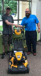 First time homebuyer Aaron with with Mortgage Loan Officer Michael Garcia (and his new lawnmower)
