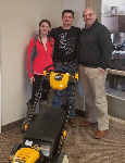 1st time Homebuyers pictured with their new lawnmower and Scott White, Mortgage Lender