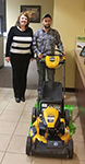 1st-time Home buyer Nick pictured with his new free lawnmower and Molli Hundt, Mortgage Loan Officer