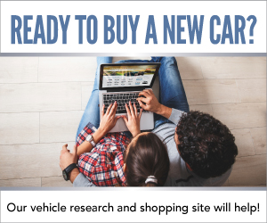 two people looking at a laptop. Ready to buy a new car? Our vehicle research and shopping site will help!